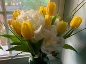 A flower arrangement by RenaissanceLista - yellow tulips and white peonies.